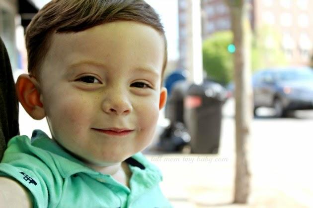 toddler smiling wearing cute teal shirt